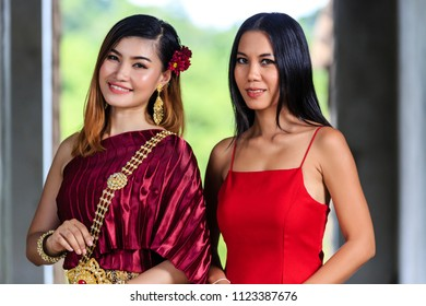 2 Beautiful Women - with Thai Traditional Dress King Rama 1 and Red Dress posing in old building