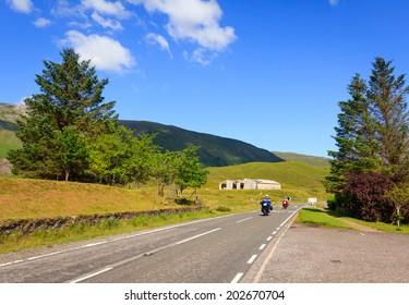 2 bikers riding on the mountainous A87 road in Glen Moriston, Scotland