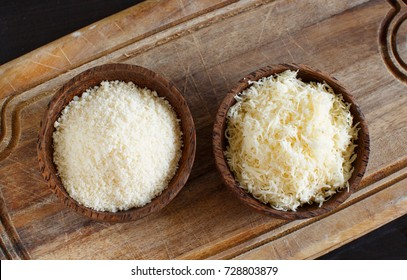 2 Bowls with grated parmesan cheese  top view