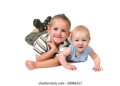 2 Brothers Posing for a Portrait Lying on Their Stomachs