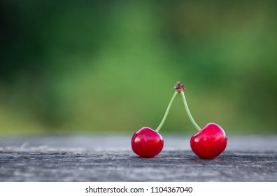 2 cherries in the open air on the background of nature