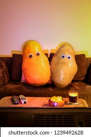 2 couch potatoes watching tv