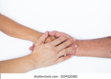 2 Daughters in middle age put their hands on the father's hand who get sick for sending the power will , love, trust, and caring together, give family values, closeup subject show isolated background