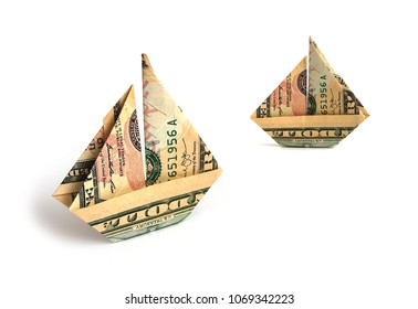 2 dollar bills in the form of sailboats on a white background