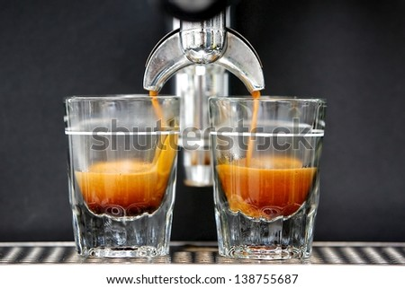 2 Espresso Shots Getting Brewed Into Shot Glasses