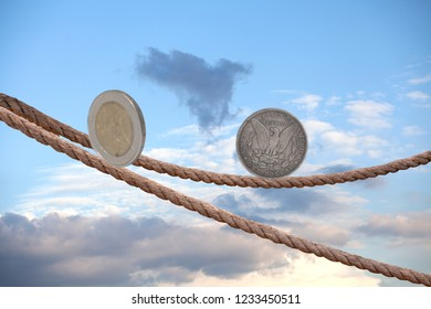 2 Euro coin and one dollar coin balancing on rope in the sky.