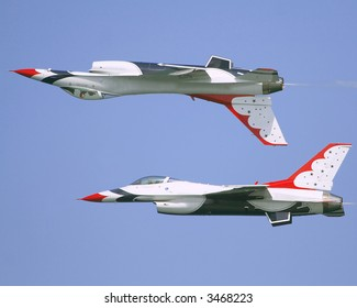 2 F16 Thunderbirds in a aerial display involving the downside up maneuver. The F-16 Fighting Falcon is a multirole jet fighter aircraft