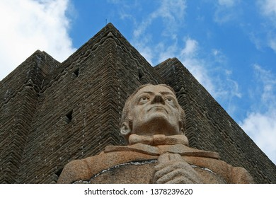 2 FEB 2017 VOORTREKKER MONUMENT, PRETORIA - UPWARD VIEW OF STATUE ON CORNER OF VOORTREKKER MONUMENT WITH MONUMENT IN THE BACKGROUND