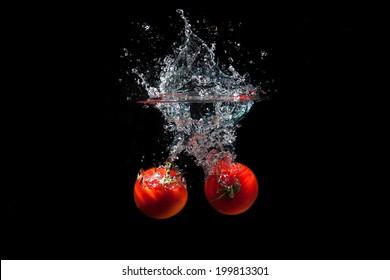 2 Fresh Red Tomatoes Splash in Water