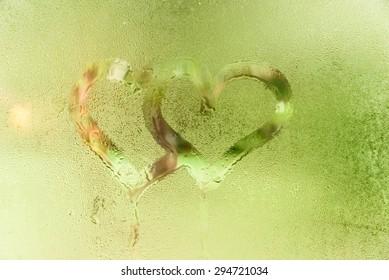 2 heart shapes on steam glass window
