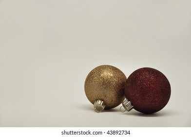 2 isolated christmas ornaments