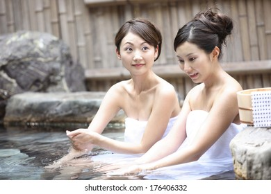 2 Japanese woman are in the open-air bath