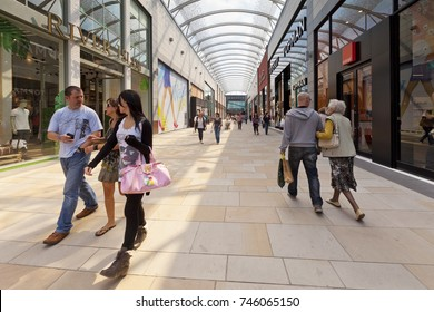 2 June 2011: Wakefield, West Yorkshire, England, UK - People walking in Trinity Walk, Wakefield's new shopping mall.