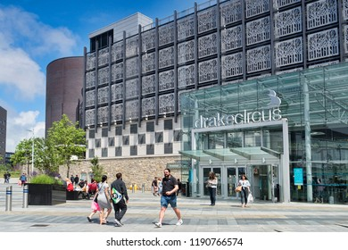 2 June 2018: Plymouth, Devon, UK - Drake Circus Shopping Centre on a bright and warm spring day, with shoppers entering and leaving.