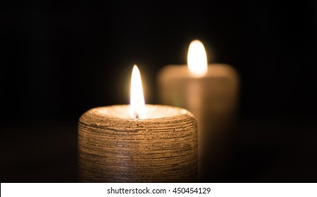 2 Lighted Candle in dark Room.