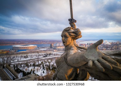 2 march 2019, Volgograd Russia. Close aerial view of the monument The Motherland Calls (Rodina-mat zovet) on the top of the Mamaev Hill and the football stadium Volgograd Arena built for the World Cup