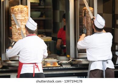 2 men who cut meat.