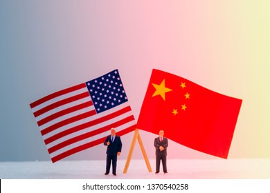 2 Miniature figure with USA and China flags. Its is symbol for tariff trade war crisis or unfair business of 2 biggest economic countries in the world.