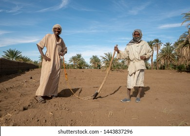 2 Nubian in traditional clothing farmers posing for a picture in their field - Abri, Sudan - 11 30 2018