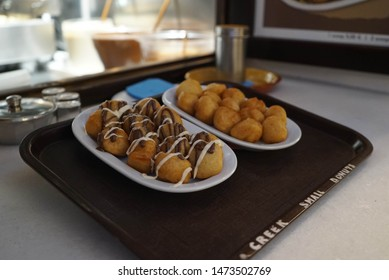 2 plates of loukoumades presented in the island of paros