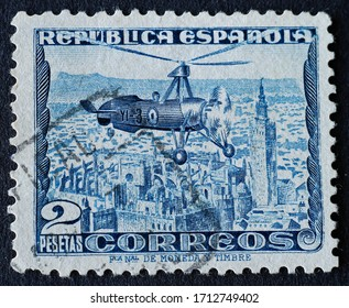 2 pts blue stamp of autogyro a type of rotorcraft that uses an unpowered rotor in free autorotation to develop lift, of a spanish aeronautical engineer. Stamp issued on June 1, 1935, Madrid, Spain.