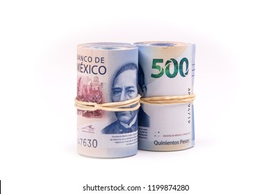 2 rolls of 500 mexican pesos notes on white background