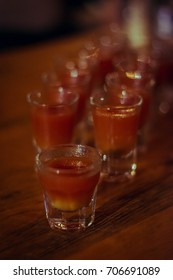 """2 rows of shots """"Russian Breakfast"""", lined up, first shot is in focus, rest are blurry"""