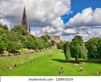 2 September 2016:Edinburgh, Scotland - People sunbathing in Princes Street Gardens on a fine day in early autumn, with with Scott Monument and the Balmoral Hotel.