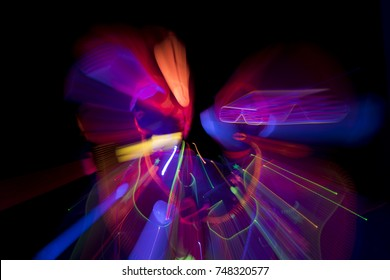 2 sexy cyber glow raver women filmed in fluorescent clothing under UV black light