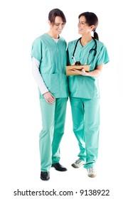 2 smiling nurses discussing a patient's file