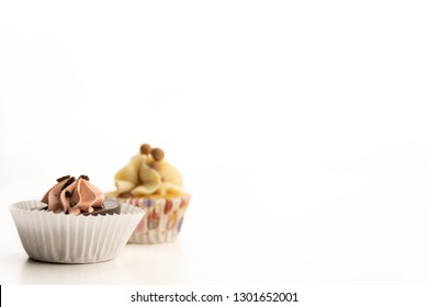 2 sweet delicious cupcakes isolated on white background. copy space available