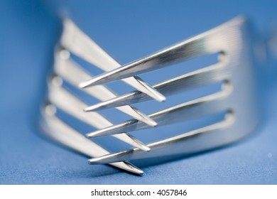 2 table forks clinched together