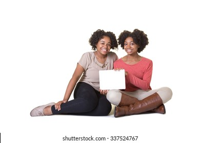 2 teenagers holding a tablet isolated on white
