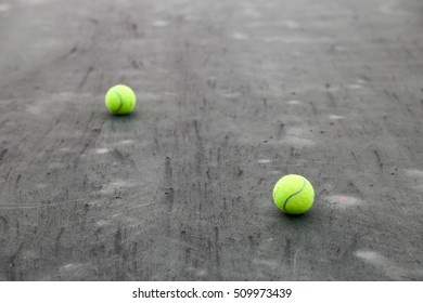 2 tennis balls on tennis hard court background.
