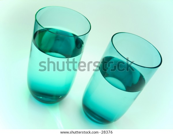 2 water glasses in vibrant blue/green colored environment