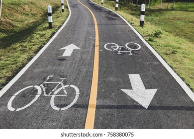 2 ways bicycle lane with bicycle sign symbol in rural country environment.