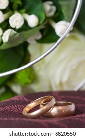2 wedding rings and flowers