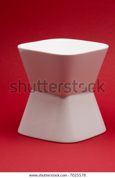 2 white bowls on a red background