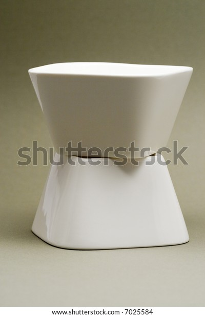 2 white bowls on a sandy background