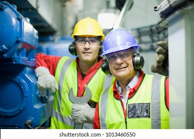 2 workers in engine room