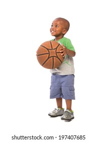 2 year old African American baby boy standing holding basket ball on isolated background
