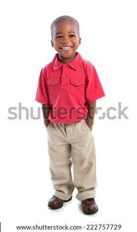 c4555bf40cfc 2 year old african american baby boy standing wearing t-shirt and dress  pants isolated on white background - Image