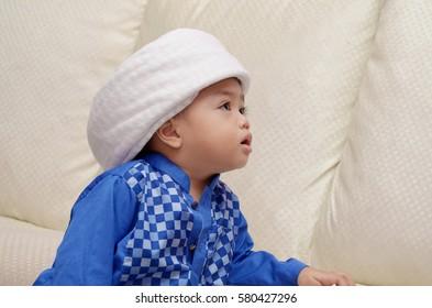 2 year old asian malay muslim child wearing turban