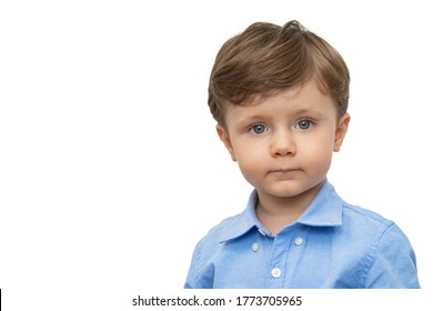 2 year old caucasian boy in portrait pose, with blue collar shirt, on White background and copy space