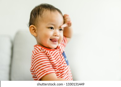 2 year old toddler asian boy uncontrollable and bad behavior and show funny face at home.Attention deficit hyperactivity disorder (ADHD) Concept.