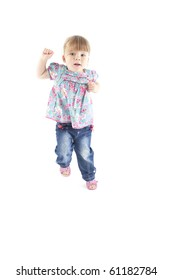 2 year old toddler jumping up in the air on isolated white background