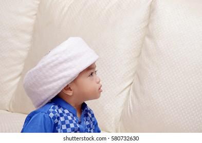 2 years old asian malay muslim child wearing turban