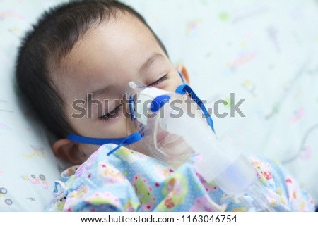 2 years old Asian toddler boy has asthma or pneumonia disease and need  nebulizations,Sick
