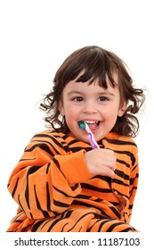 2 years old girl with toothbrush isolated on white