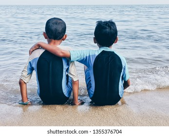 2 young brothers enjoying themselves at the seaside. Brotherhood concept